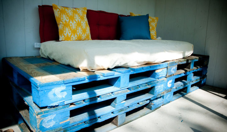 This pallet furniture is a creative way to use reclaimed pallets. Here's how to find free pallets and other materials for your DIY projects near you.
