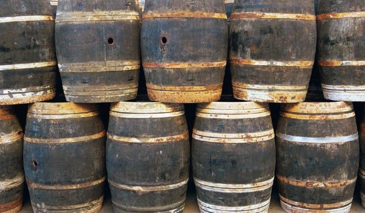 Wood barrels, plastic barrels, and metal 55 gallon barrels can be found for free -- if you know where to look for them. Start here!