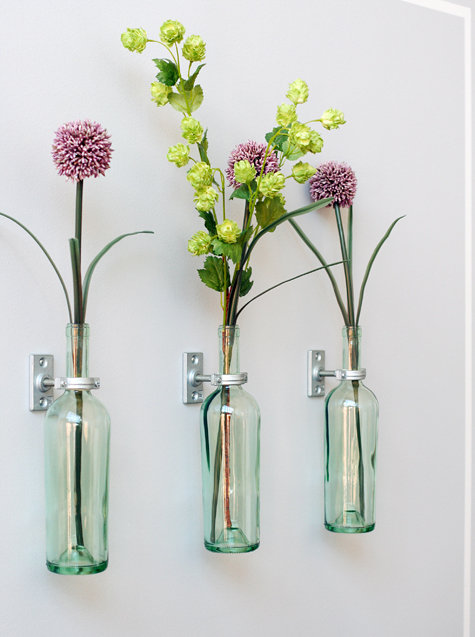 make wall mounted vases from empty wine bottles the